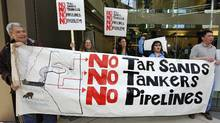 Aboriginals from British Columbia protest in front of the headquarters of Enbridge before the company's annual general meeting in Calgary, Alberta, May 11, 2011. (Todd Korol/ Reuters/Todd Korol/ Reuters)