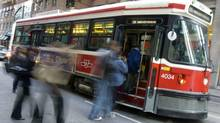 A file photo shows a TTC streetcar taking on passengers in Toronto.