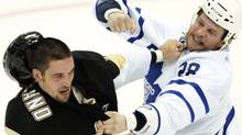 Pittsburgh Penguins' Deryk Engelland (L) fights with Toronto Maple Leafs Colton Orr (28) in the second period of their NHL hockey game at the Consol Energy Center in Pittsburgh, Pennsylvania October 13, 2010. REUTERS/David DeNoma (DAVID DENOMA)