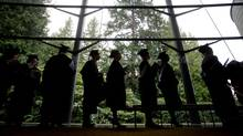 University of British Columbia students are silhouetted as they wait to enter a ceremony where they received their degrees during a fall convocation ceremony at the university in Vancouver, B.C., on Wednesday November 21, 2012. (DARRYL DYCK For The Globe and Mail)