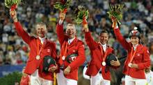 Canada's show jumping squad, from left, Mac Cone, Ian Millar, Eric Lamaze and Jill Henselwood, brought home silver medals from the equestrian team competition at the 2008 Beijing Summer Olympics. (Susan Walsh/AP)