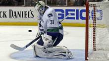 Vancouver Canucks goalie Eddie Lack blocks a shot on goal by the Anaheim Ducks in the second period of an NHL hockey game in Anaheim, Calif., Sunday, Nov. 10, 2013. (Associated Press)
