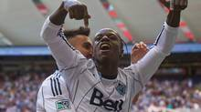 Vancouver Whitecaps' Darren Mattocks, of Jamaica, and Pedro Morales, back, of Chile, celebrate Mattocks' goal against Sporting Kansas City during the first half of an MLS soccer game in Vancouver, B.C., on Sunday August 10, 2014. (DARRYL DYCK/THE CANADIAN PRESS)