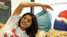 Anupama Vittal, CEO of the Bean Bag Factory Inc., stretches as part of her rehab routine after injuring her knee. (Fernando Morales/The Globe and Mail/Fernando Morales/The Globe and Mail)