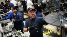 A man is seen at work in the Bosch factory auto-parts production line in San Luis Potosi, Mexico. (PEDRO PARDO/AFP/Getty Images)