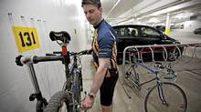 Shawn Bravender, 41, an associate in the planning department of Stantec in Edmonton tweaks his bike on the company repair station in the parkadae below Stantec. (Jason Franson for The Globe and Mail/Jason Franson for The Globe and Mail)