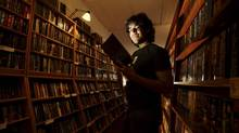 Aaron Swartz committed suicide earlier this month at 26. Mr. Swartz was facing time in jail and a possible $1-million fine as a result of being prosecuted for breaking into MIT's computers to download millions of articles from JSTOR, an online academic database. (NOAH BERGER/Reuters)