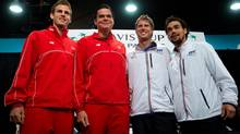 From left to right, Canada's Vasek Pospisil, of Vernon, B.C., and Milos Raonic, of Toronto, Ont., and Italy's Andreas Seppi and Fabio Fognini pose for photographs after the draw for this weekend's Davis Cup tennis quarter-final tie in Vancouver, B.C., on Thursday April 4, 2013. (DARRYL DYCK/THE CANADIAN PRESS)