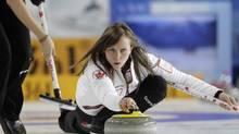 Canada's skip Rachel Homan (R) delivers the stone during their World Women's Curling Championship qualification round match against Scotland in Riga March 16, 2013. (INTS KALNINS/REUTERS)