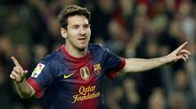 Barcelona's Lionel Messi celebrates a goal against Zaragoza during their Spanish First division soccer league match at Camp Nou stadium in Barcelona, November 17, 2012. (ALBERT GEA/REUTERS)