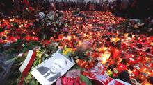 A portrait of late Polish President Lech Kaczynski lies among a sea of candles and flowers laid by mourners outside the Presidential Palace on April 10, 2010 in Warsaw, Poland. (Sean Gallup/Photo by Sean Gallup/Getty Images)