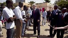 Prime Minister Stephen Harper shakes hands with students at a vocational school in Dakar, Senegal, on Oct. 11, 2012. (JOE PENNEY/REUTERS)