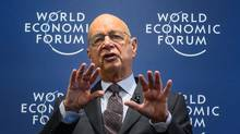 World Economic Forum founder and executive chairman Klaus Schwab speaks during a news conference on Wednesday. (FABRICE COFFRINI/AFP/Getty Images)