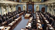 Members of the National Assembly honour the memory of the 14 women who died in the École Polytechnique massacre on Thursday in Quebec City. Twenty-five years after the tragedy, relaxed gun rules are looming. (Jacques Boissinot/THE CANADIAN PRESS)