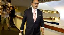 Toronto City Councillor Denzil Minnan-Wong walks away after speaking to the media outside of the reception area of the Mayor's office at City Hall in Toronto on May 31, 2013. (Peter Power/The Globe and Mail)