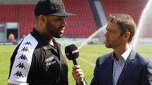 Toronto Wolfpack rugby player Ryan Bailey is interviewed by Aaron Murphy of Premier Sports TV. (Toronto Wolfpack/The Canadian Press)