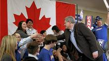 Stephen Harper greets supporters during a campaign rally in Guelph, April 4, 2011. (CHRIS WATTIE/CHRIS WATTIE/REUTERS)