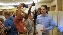 Republican Wisconsin Governor Scott Walker, who is facing a recall election, casts his vote on election day in Wauwatosa, Wisconsin June 5, 2012. The rematch with Milwaukee's Democratic Mayor Tom Barrett, who Walker defeated in a Republican sweep of the state in 2010, is the end-game of six months of bitter fighting in the Midwestern Rust Belt state over the union restrictions Walker proposed and enacted. (Darren Hauck/Reuters/Darren Hauck/Reuters)