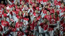 Members of the Canadian delegation wave to the crowd during the July 10 opening ceremony for the 2015 Pan Am Games in Toronto. (Matt Detrich/USA Today Sports)
