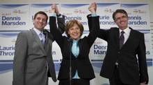Liberal candidate Dennis Marsden for Port Moody-Coquitlam, Premier Christy Clark and Liberal candidate Laurie Throness for Chilliwack-Hope join hands during a joint press conference in Port Moody. (John Lehmann/The Globe and Mail/John Lehmann/The Globe and Mail)