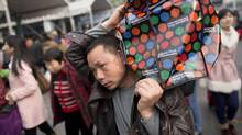 Passengers lineup outside Guangzhou railway station to board their train January 10, 2013. (John Lehmann/The Globe and Mail)