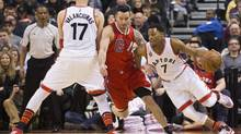 The Toronto Raptors' Kyle Lowry drives past the L.A. Clippers' J.J. Redick (C) during the first half of their NBA basketball game in Toronto on Sunday January 24, 2016 . Toronto won, and now has its second-longest winning streak in history. (Mark Blinch for the Globe and Mail)