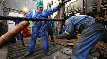 Workers at a Precision Drilling rig. (Nathan VanderKlippe For The Globe and Mail)