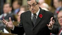 Industry Minister Tony Clement shrugs while responding to opposition criticism during Question Period in the House of Commons on Tuesday, November 3, 2009. (Adrian Wyld)