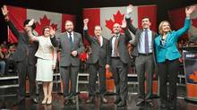 Candidates Martin Singh, Niki Ashton, Thomas Mulcair, Brian Topp, Nathan Cullen, Paul Dewar and Peggy Nash wave to the crowd during the final NDP leadership debate in Vancouver on March 11, 2012. (BEN NELMS/Ben Nelms/Reuters)