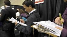 File photo of job seekers lining up at a job fair in Toronto. (J.P. MOCZULSKI For The Globe and Mail)