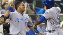 Kansas City Royals' Lorenzo Cain, right, is congratulated by Salvador Perez after he hit a two run home run off Toronto Blue Jays starting pitcher J.A. Happ during eighth inning AL baseball game action in Toronto Friday May 30, 2014. (Fred Thornhill/THE CANADIAN PRESS)