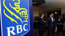 Shareholders leave the Royal Bank of Canada annual meeting in Calgary, on Feb. 28, 2013. THE CANADIAN PRESS/Jeff McIntosh