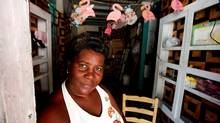 Molver Desir, owner of Nini's Gift shop stands in her damaged shop in Jacmel, Haiti, Feb. 10, 2010. Desir lost a significant amount of stock in the earthquake and is also in a great deal of debt because her husband is ill. (Deborah Baic/THE GLOBE AND MAIL)