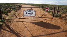 The entrance gate to Steenkampskraal mine, located in a remote corner of South Africa's Western Cape province. The mine was abandoned in 1963 and is now being turned into a rare-earth facility. (Erin Conway-Smith/Erin Conway-Smith for The Globe and Mail)