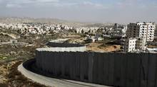 Dismantling of the security wall that cuts off Palestinian communities from Israel is one of the demands of the Boycott, Divestment and Sanctions movement that has been condemned in a parliamentary vote. (Baz Ratner/REUTERS)