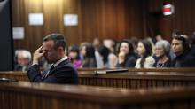 Olympic and Paralympic track star Oscar Pistorius reacts during his trial at North Gauteng High Court in Pretoria April 15, 2014. (SIPHIWE SIBEKO/REUTERS)