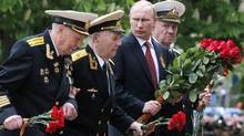 Russian President Vladimir Putin's visit to Crimea was denounced, with the U.S. calling it provocative, NATO Secretary-General Anders Fogh Rasmussen declaring it 'inappropriate' and Ukrainian Prime Minister Arseny Yatseniuk saying: 'Sixty-nine years ago, we, together with Russia, fought against fascism and won.' Now, he added, 'history is repeating itself but in a different form.' (MAXIM SHEMETOV/REUTERS)