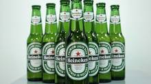 Heineken beer bottles displayed at a press conference in London, Jan. 25, 2008. (SANG TAN/AP)