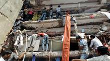 Rescuers look for survivors in the debris of a building that collapsed in Savar, near Dhaka, Bangladesh. (A.M. Ahad/AP)