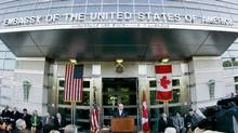 Then-U.S. ambassador David Wilkins addresses a crowd outside the U.S. embassy in Ottawa in this 2005 file photo. (JIM YOUNG/JIm Young/Reuters)