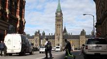 Police officers crossing the street in front of the the Parliament building after a sentry guard was shot October 22, 2014 in Ottawa. Dave Chan for The Globe and Mail. (Dave Chan For The Globe and Mail)