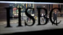 Pedestrians pass in front of HSBC Holdings Plc signage displayed near Bay Street in Toronto, Ontario, Canada, on Monday, Aug. 29, 2011. Bay Street is the center of Toronto's Financial District and is often used as a metaphor to refer to Canada's financial industry. Photographer: Brent Lewin/Bloomberg (Brent Lewin/Bloomberg)