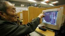 Chinese investor monitors a screen at a Beiging stock brokerage. Even with stocks rising, investors are nervous. Trading volumes in the past month are 14 per cent below the first half of last year. (Ng Han Guan/Associated Press/Ng Han Guan/Associated Press)