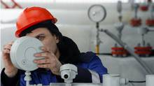 A Gazprom technician works on a pressure gauge at the gas export monopoly's Sudzha compressor station. Gazprom supplies about a quarter of Europe's gas. (Denis Sinyakov/REUTERS)