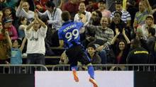 Montreal Impact forward Jack McInerney (99) reacts after scoring a goal against the Chicago Fire during the first half at Olympic Stadium. (Eric Bolte/USA Today Sports)
