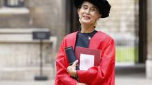 Ms. Suu Kyi poses for a photograph after receiving an honourary degree from Oxford University, in Oxford southern England on June 20, 2012. (Andrew Winning/REUTERS)