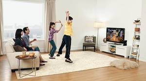 Microsoft's depiction of a family enjoying Kinect in their living room.