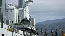 Crew members of HMCS Protecteur leave the pier after after disembarking at Joint Base Pearl Harbor Hickam. (HUGH GENTRY/REUTERS)