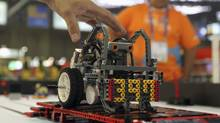 A student touches his mobilerobotduring the Worldskills Americas 2012 in Sao Paulo November 14, 2012. (Paulo Whitaker/Reuters)