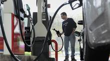 In this April 28, 2011 file photo, John Magel pumps gas at a station in Wethersfield, Conn. (Jessica Hill/ASSOCIATED PRESS/Jessica Hill/ASSOCIATED PRESS)